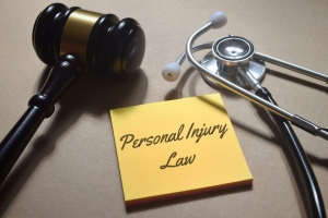personal injury law note with a gavel and a stethoscope
